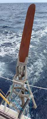 An Aries windvane self-steering gear on the stern of s/y Alacazam