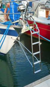 A bow ladder hung from the pushpit of a Hallberg-Rassey 42.
