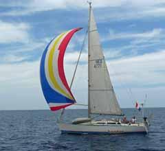 Cruiser-racer sailboat under spinnaker in the Caribbean