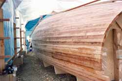 The completed cedar strip hull ready for fairing and sheathing
