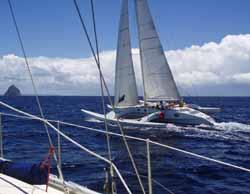 Overtaken by a cruising trimaran sailboat with Diamond Rock on the horizon
