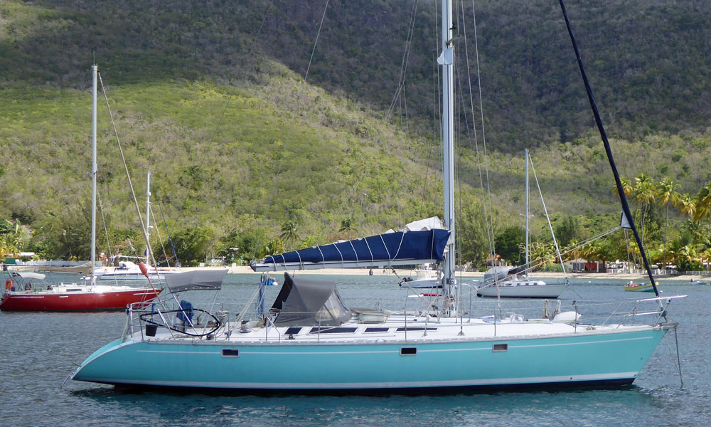 Designed by Phillipe Briand and built by Jeanneau, this 'Sun Odyssey' 47 cruising boat lies at anchor in Grande Anse D'Arlet, Martinique, French West Indies