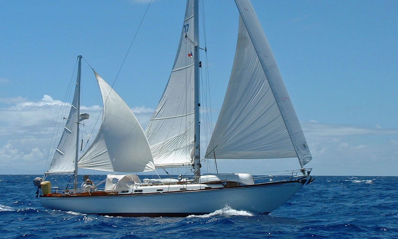 A Hinckley Sou'wester 42 yawl-rigged sailboat with mizzen staysail set.