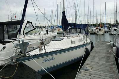 A Hughes 31 sailboat