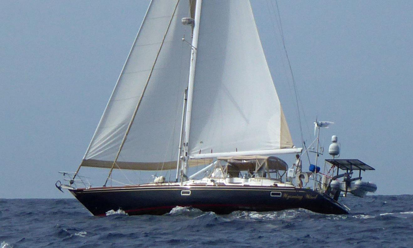A Hunter 49 cruising yacht powers to windward