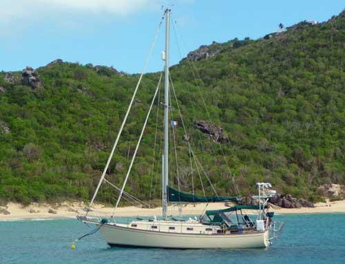 An Island Packet 35 cruising yacht at anchor