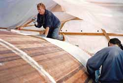 sheathing a cedar strip sailboat hull with woven rovings and epoxy