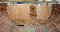 Hull interior of a part-completed cedar strip sailboat