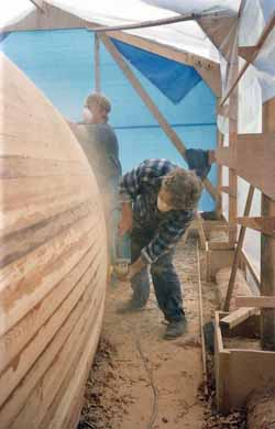 cedar strip sailboat hull sanded smooth ready for sheathing