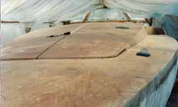 deck and coachroof fitted onto our cedar strip wood epoxy cruising sailboat