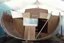 grp cockpit moulding being fitted to sailboat