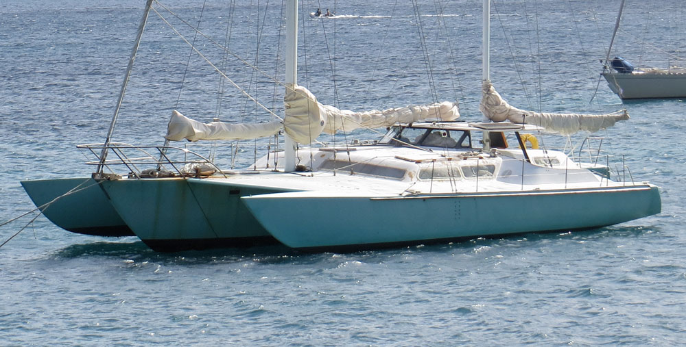 A cruising trimaran at anchor off Bequia in the West Indies