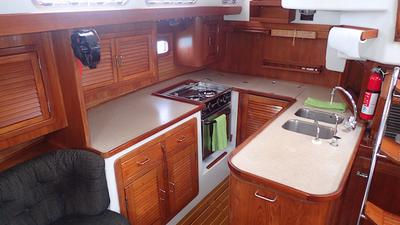 U-Shaped Galley with front and top opening refrigeration