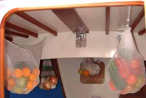 net hammocks for storing fruit on passage in a sailboat