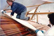 sheathing the hull of a wood-epoxy sailboat with woven glass rovings