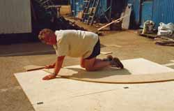 Marking out the temporary frames for a cedar strip, wood epoxy boat building project