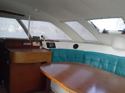 Salon with chart table, cherry interior throughout