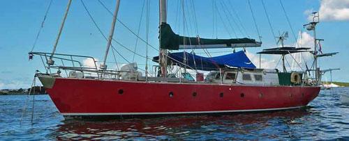 A ferrocement-hulled sailboat at anchor