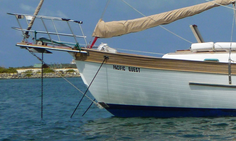 This cutter-rigged monohull needs to have its anchor snubber on a bridle to avoid chafe on the bobstay.