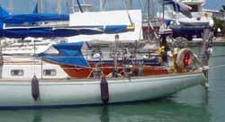 low profile style dodger (sprayhood) on sailboat