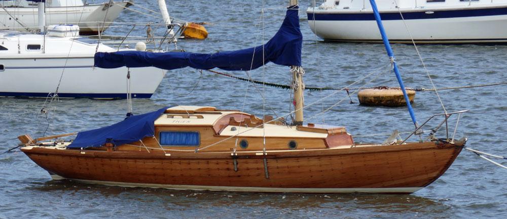 A wooden Folkboat 26 on a trot mooring.