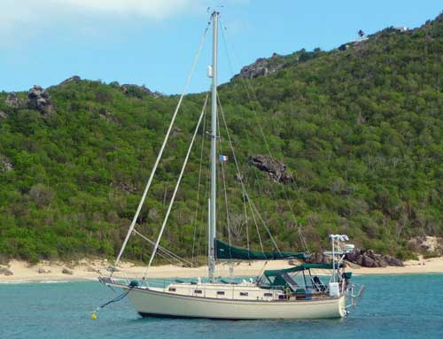 An Island Packet 35 cruising yacht at anchor