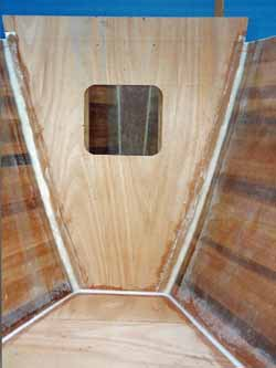 building in a collision bulkhead and watertight chamber on a wood epoxy cedar strip self build boat project