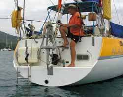 A custom designed stainless steel bathing ladder, doubling up when not in use, as a theft-proof device for the liferaft.