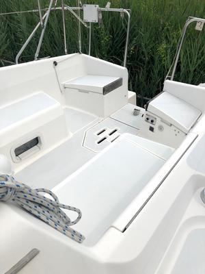 Cockpit with 9.8hp outboard engine and solar power battery charger