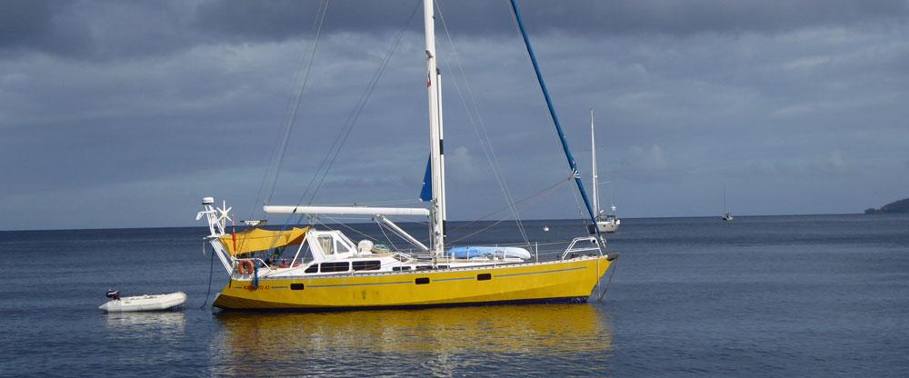 Yellow sailboat at anchor