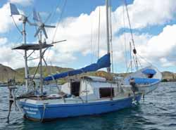 A small cruising sailboat at anchor in Falmouth Harbour, Antigua